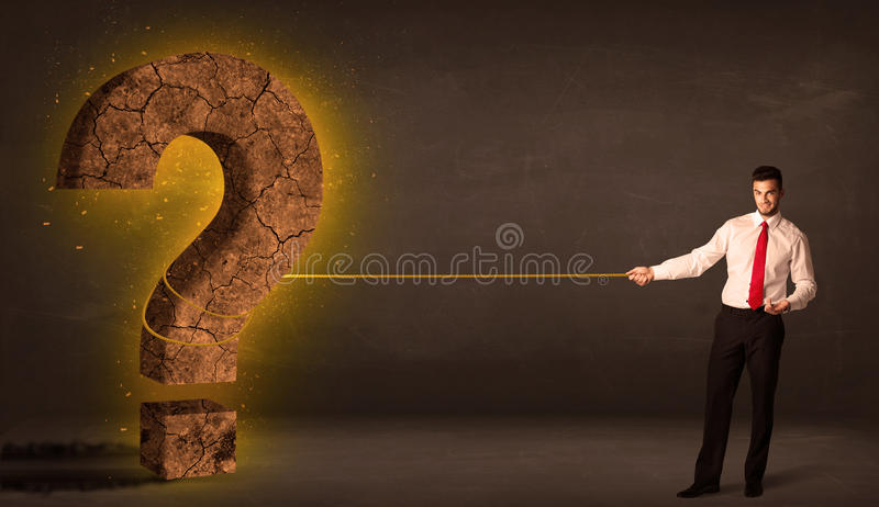 Business man pulling a big solid question mark stone. Concept on background royalty free stock images