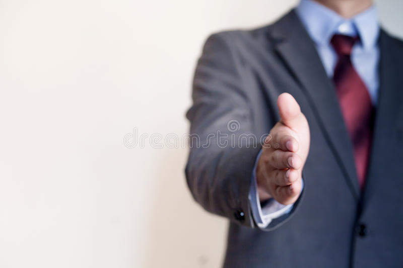 Business man reaching out hand to shake - Business Concept and G stock image