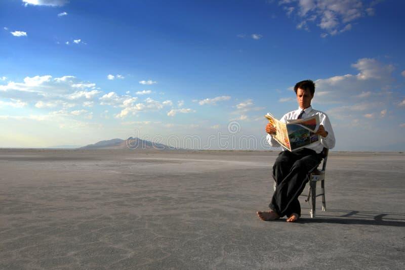 business man reading newspaper stock image
