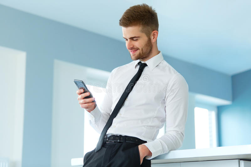 Business Man Reading Something on the Screen of His Cell Phone royalty free stock images