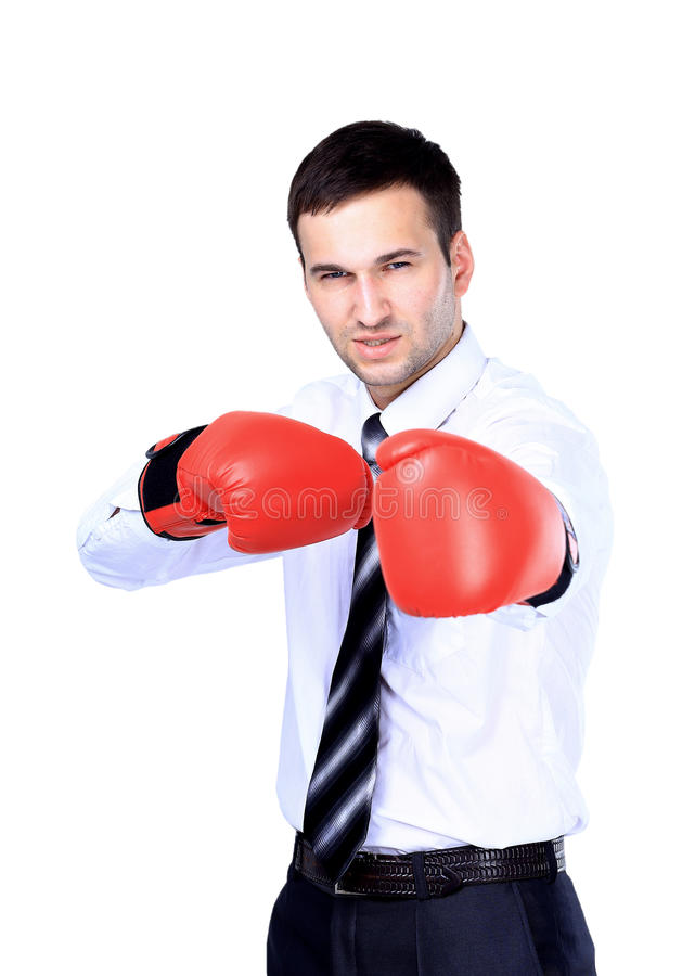 Business man ready to fight with boxing gloves. Isolated over white background royalty free stock photo