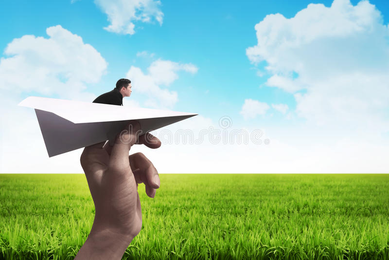 Business man ready to launch with the paper plane. Business career concept stock photography