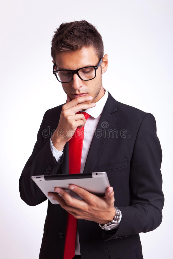Download Business Man Reaing News On His Pad Stock Photo - Image: 26587324