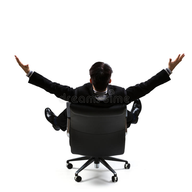Business man in rear view sitting on a chair and open arms. Isolated over white royalty free stock images
