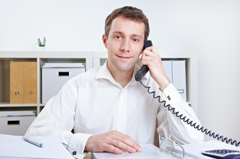 Business man receiving a phone call royalty free stock photos