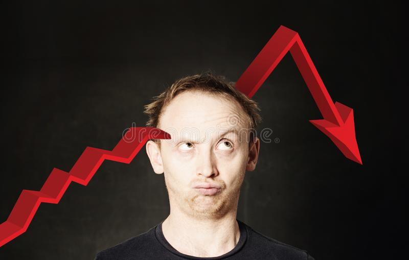 Business man and red arrow. Crash of investments and crisis concept stock images