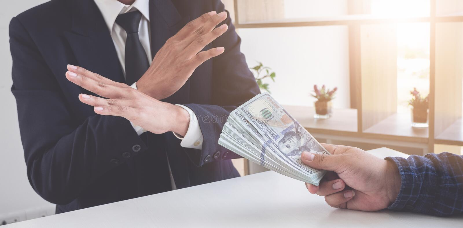 Business man refusing money to take the bribe the concept of corruption and anti bribery.  royalty free stock images