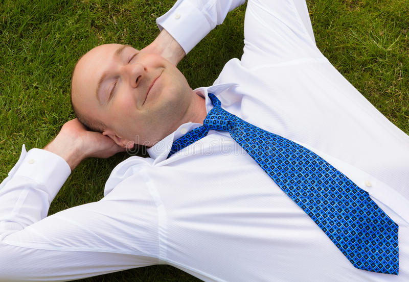 Business man relaxing royalty free stock photography