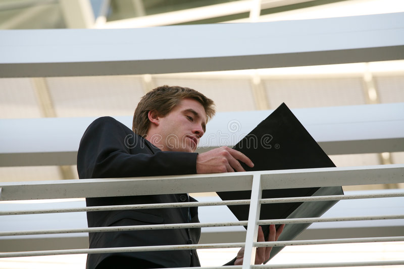 Business Man Reviewing Notes royalty free stock image