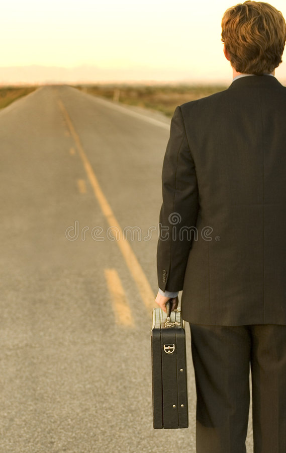Business man on road royalty free stock photo