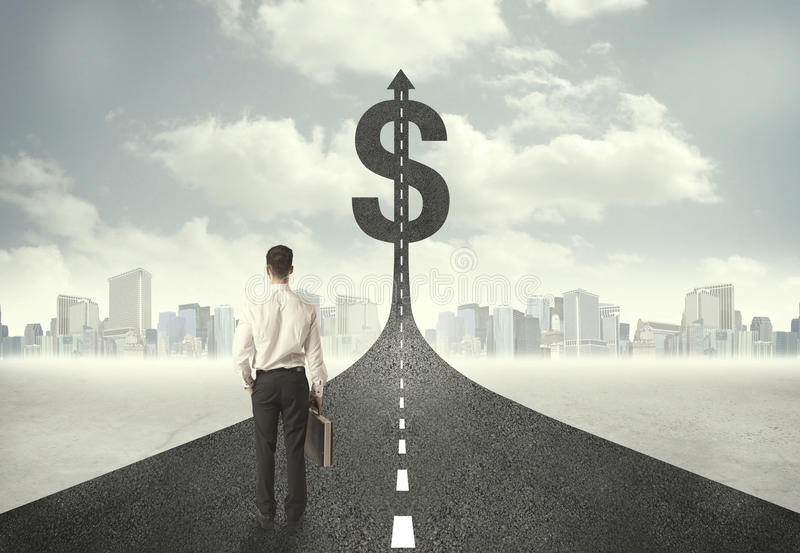 Business man on road heading toward a dollar sign royalty free stock photography