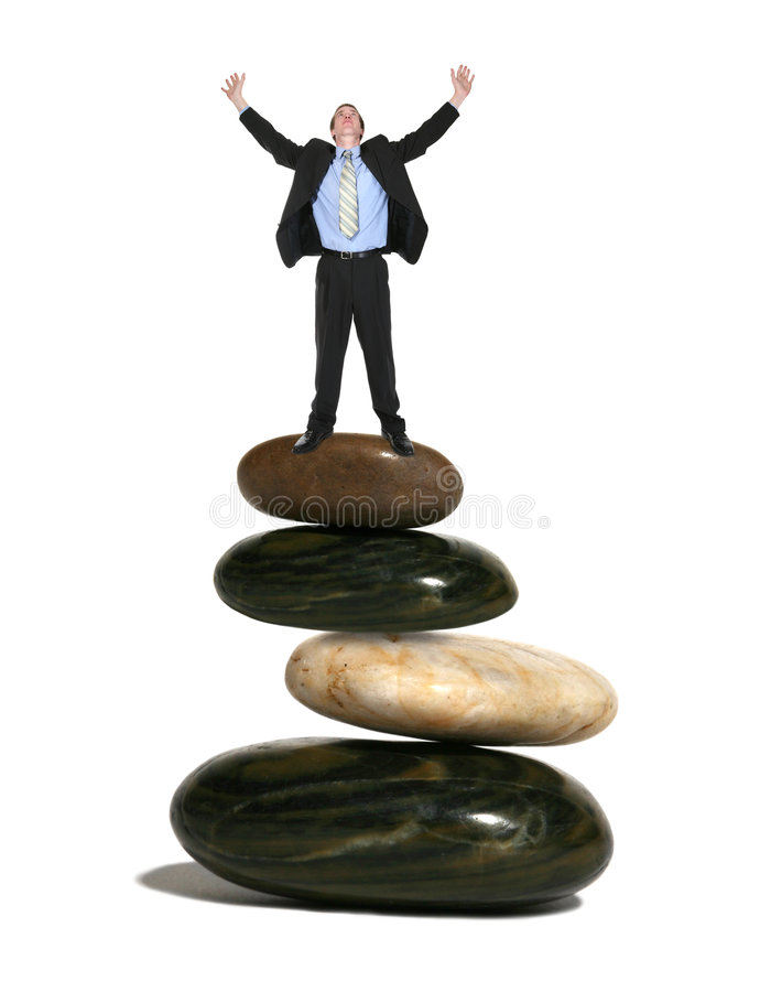 Business Man on Rocks stock photo