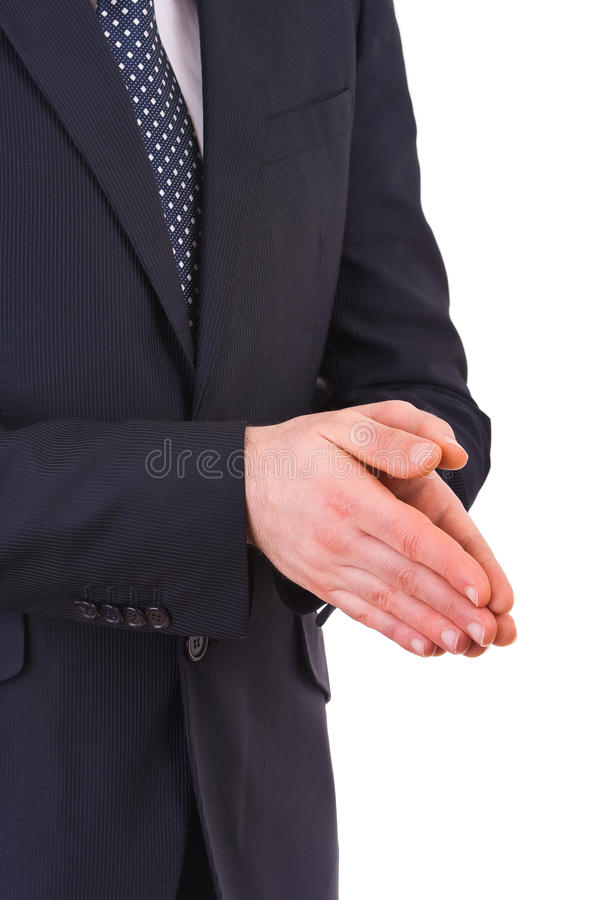 Businessman rubbing his hands together. Business man rubbing his hands together stock photo