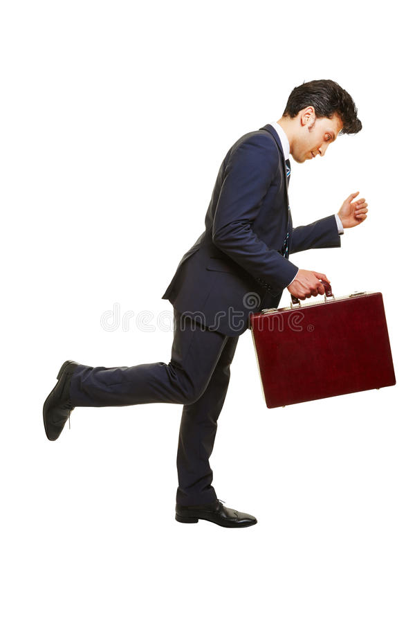 Business man running with briefcase. Side view of business man running with a briefcase stock images