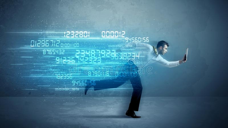 Business man running with device and data concept royalty free stock photo