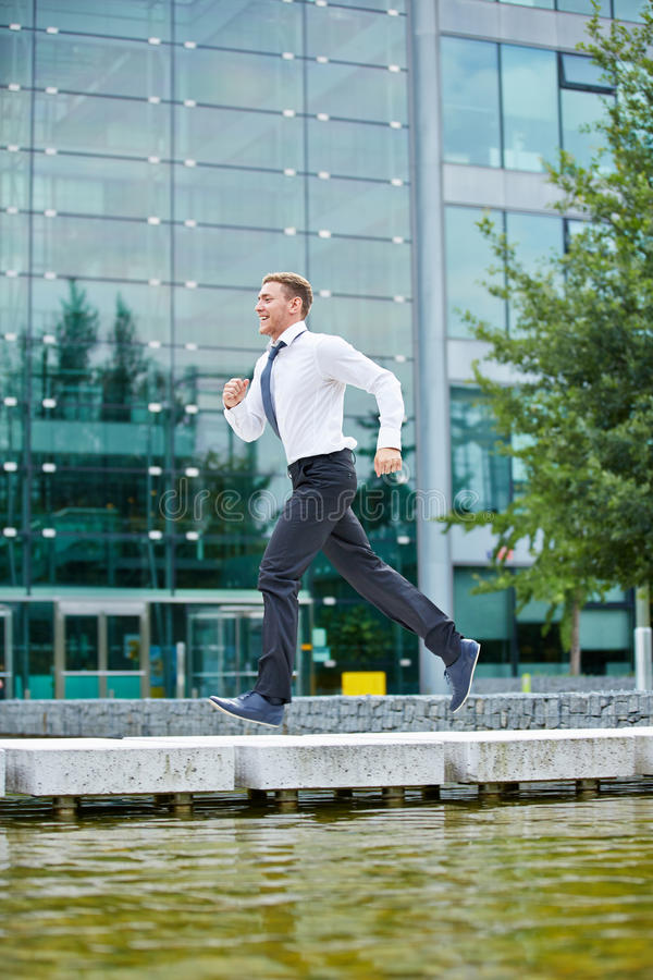 Business man running to appointment royalty free stock image