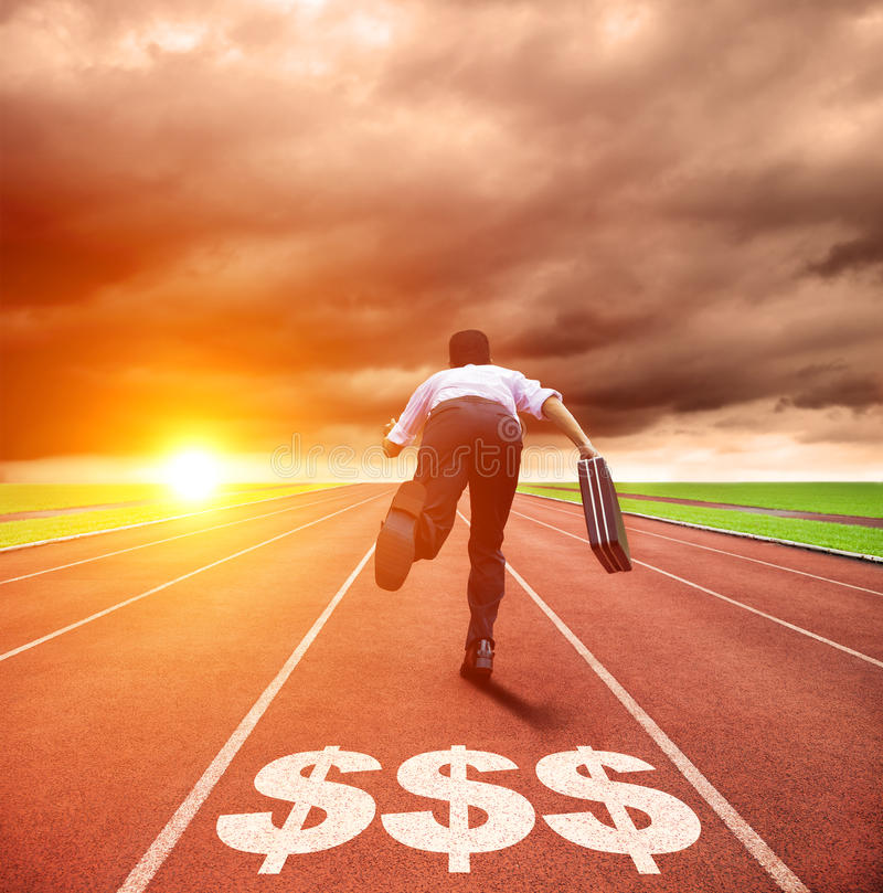 Business man running on track with money sign. Young business man running on track with money sign stock images