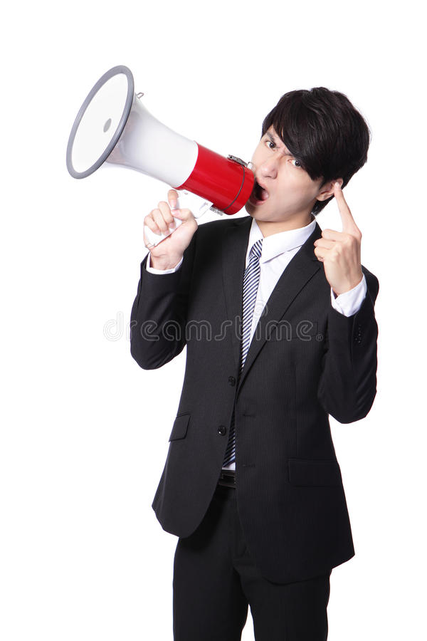 Business Man Screaming Loudly In A Megaphone Stock Photo