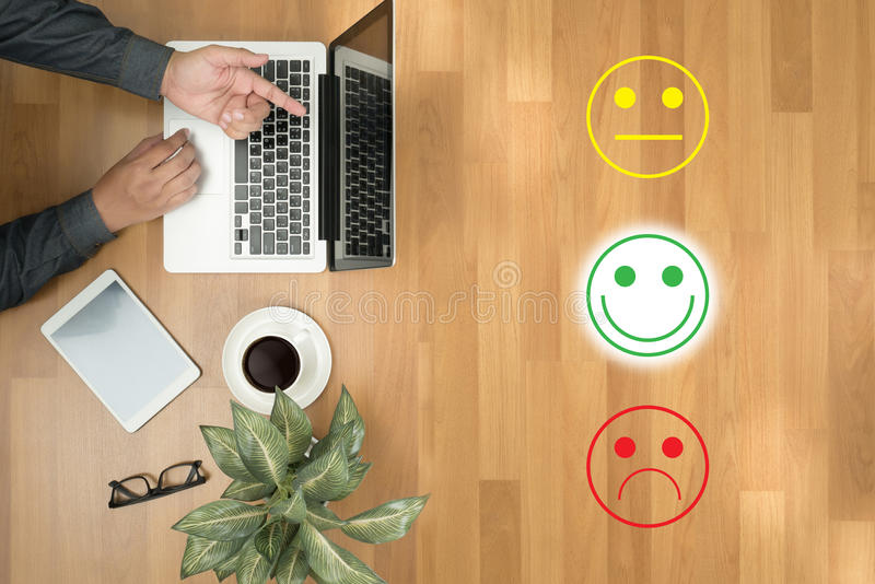 Business man select happy :) :l :( business man select happy on. Happy, selection, select, survey, feedback, customer, hand, happiness, business, choice stock photography