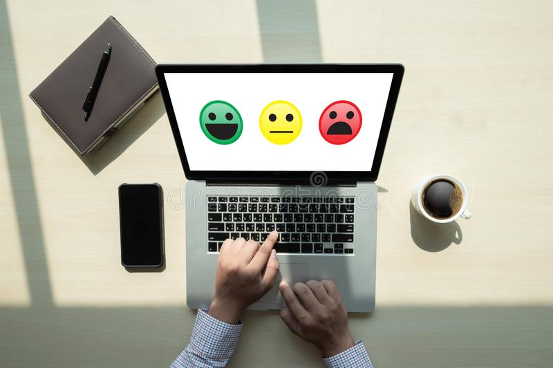 Business man select happy on satisfaction evaluation? And good m. Ood smiley stock image