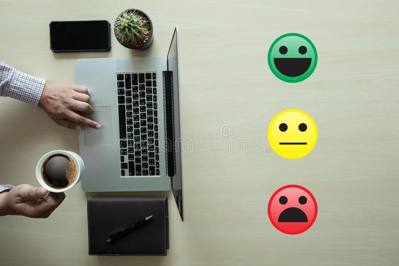 Business man select happy on satisfaction evaluation? And good m. Ood smiley royalty free stock photography