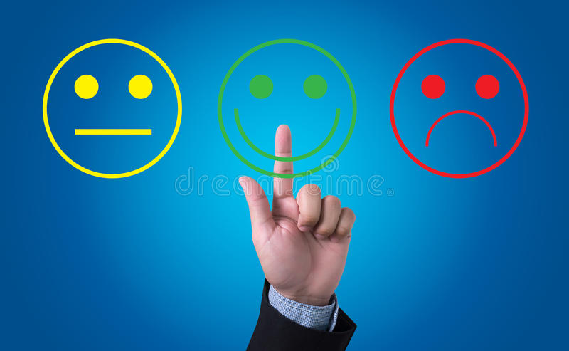 Business man select happy on satisfaction evaluation?. Business man with hand pressing a button royalty free stock photography