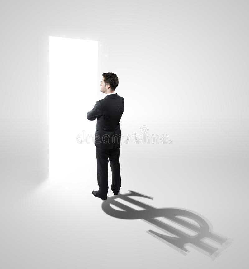 Business man with a shadow shaped as currency sing stock photo