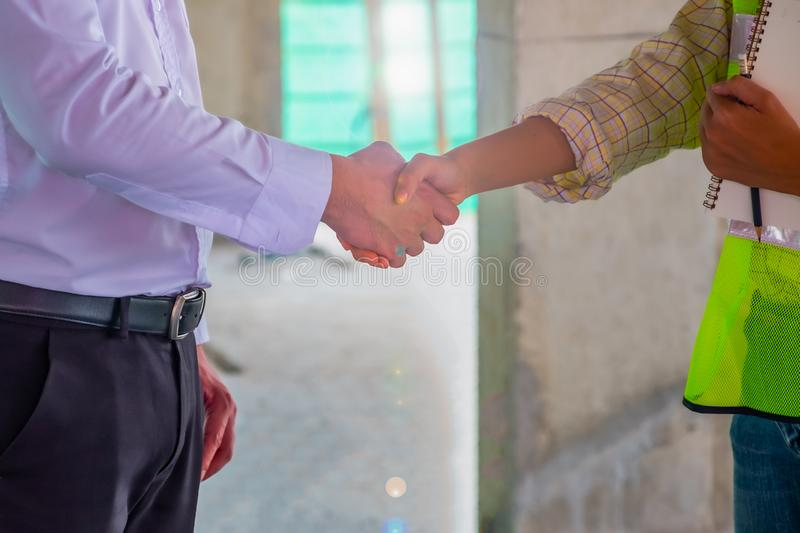 Business man is shaking hand with his operator after meeting in building site. Adult, agreement, background, businessman, businessmen, commerce, communication royalty free stock images
