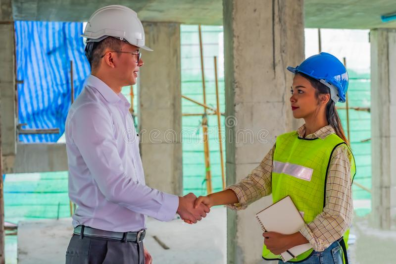 Business man is shaking hand with his operator after meeting in building site royalty free stock image