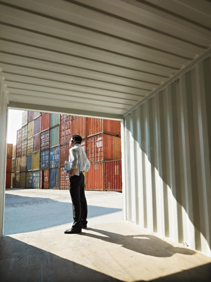 Download Business Man With Shipping Containers Royalty Free Stock Photography - Image: 14768997