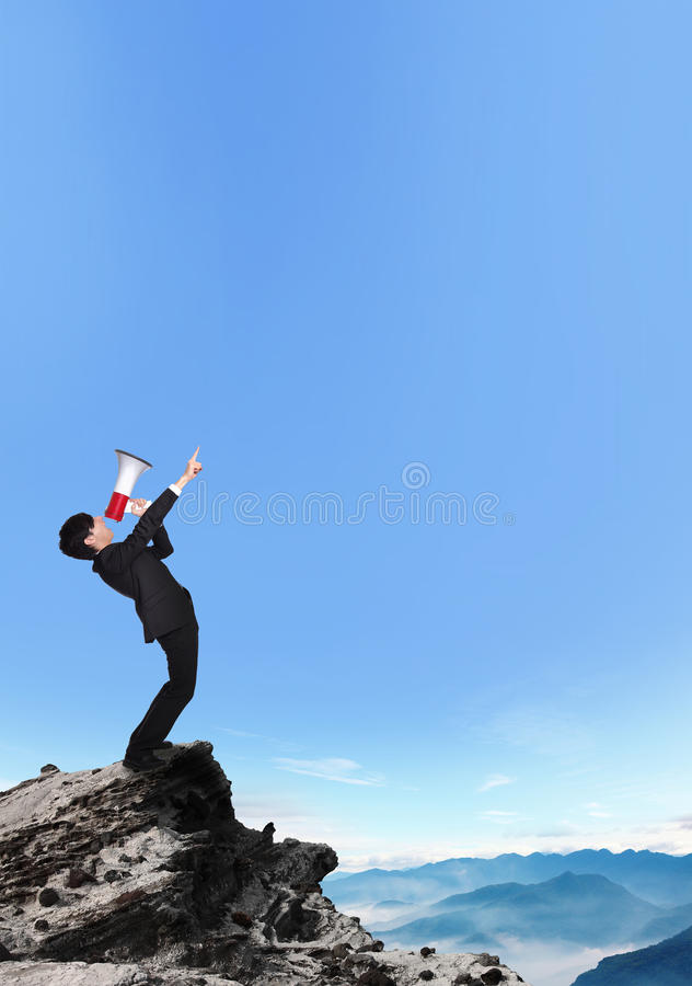 Business man shouting into a megaphone royalty free stock photos