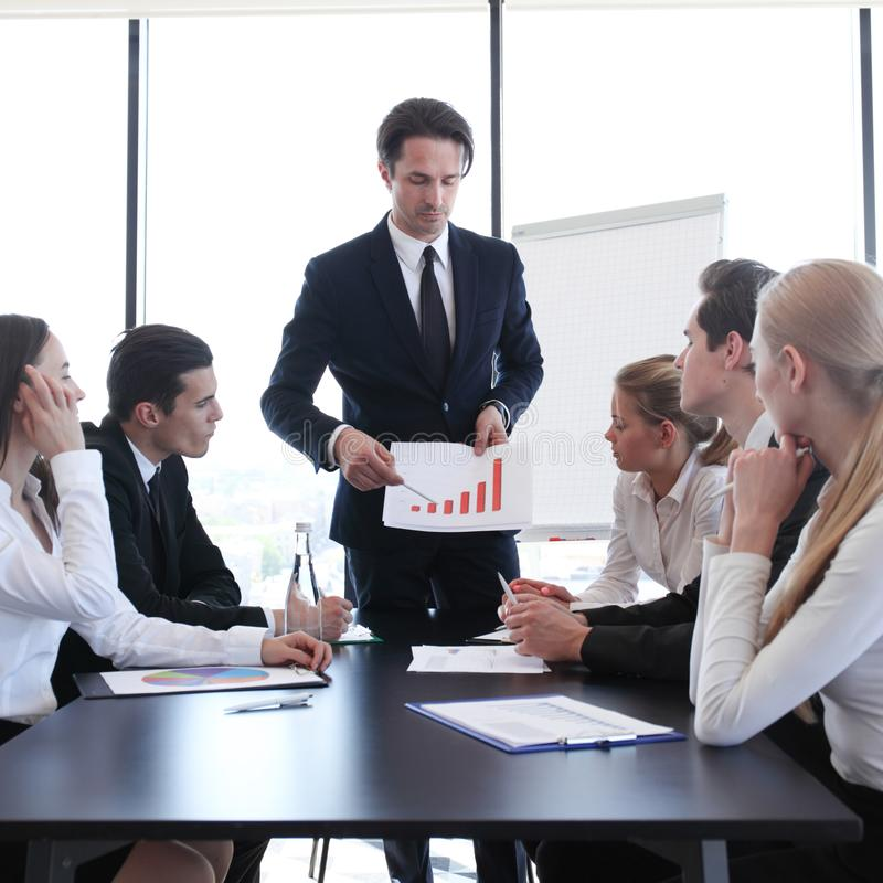 Business man show graph at meeting royalty free stock image