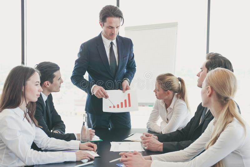 Business man show graph at meeting stock photography