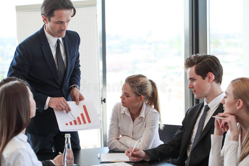 Business man show graph at meeting stock photos