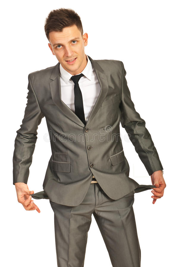Business man showing empty pockets stock image