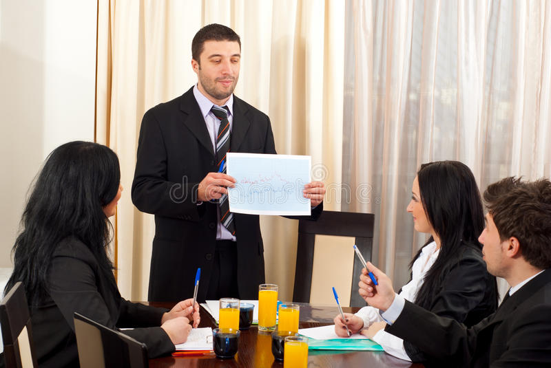 Business man showing graphic at meeting