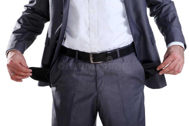 Business man showing his empty pockets 2. Business man in a suit standing with his hand showing his empty pockets royalty free stock photo