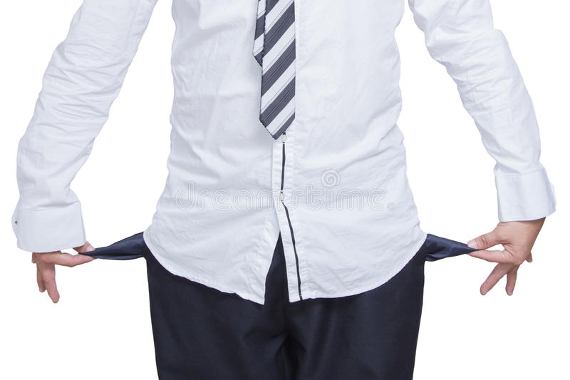 Business man showing his empty pockets on white stock photography