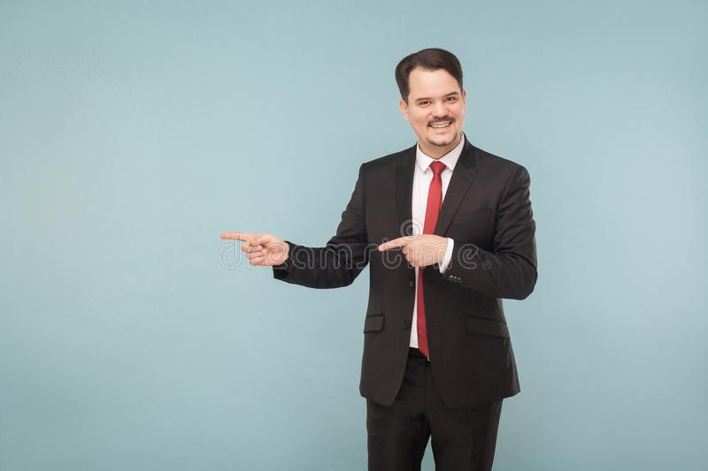 Business man showing left or right at copy space royalty free stock photography