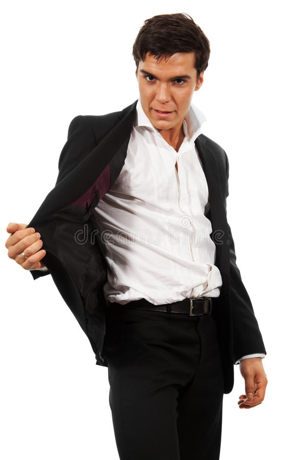 Business man showing a magic trick stock photography