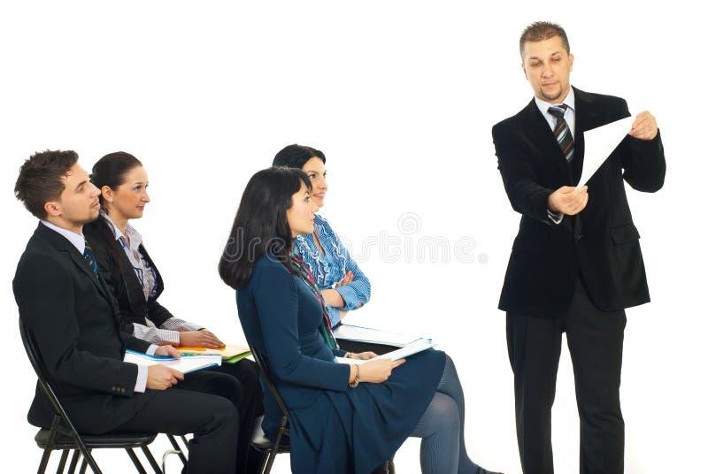 Business Man Showing Paper At Seminar Stock Photo