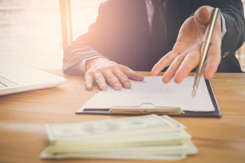 Business man signing a contract. Owns the business sign personally, director of the company, solicitor. Real estate agent holding royalty free stock photos