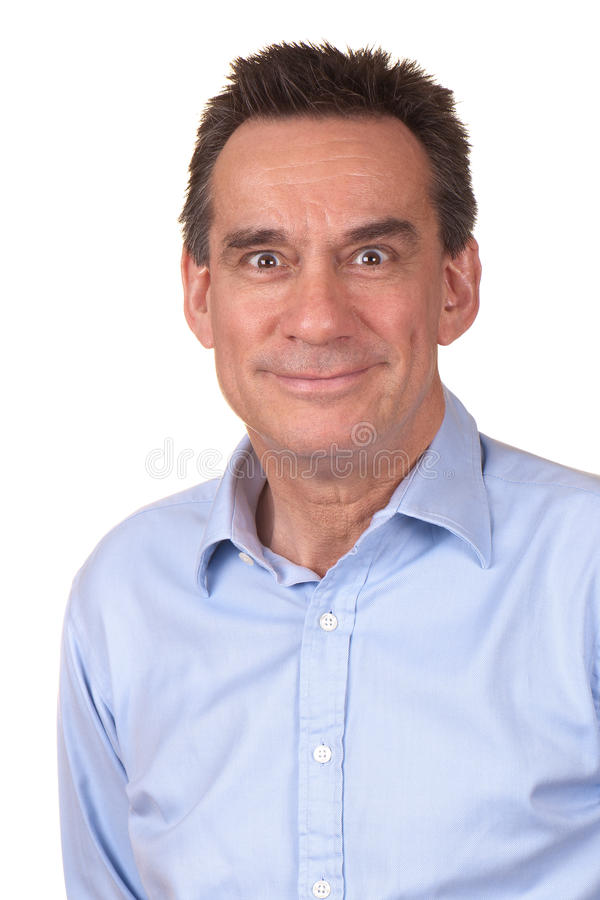 Business Man with Silly Smile and Funny Face. Attractive Middle Age Man in Blue Shirt with Silly Smile and Funny Expression stock photo