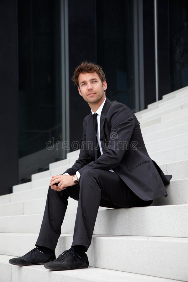 Free Business Man Siting On Stairs Royalty Free Stock Image - 19609796