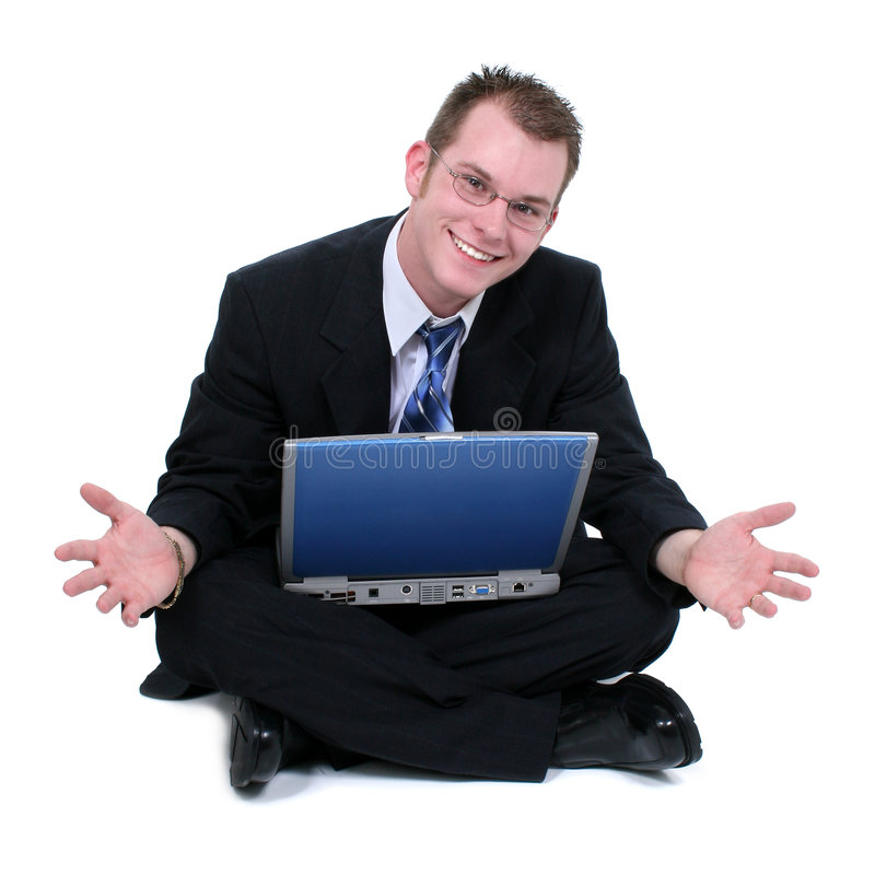 Business Man Sitting On Floor With Laptop Hands Out royalty free stock photo