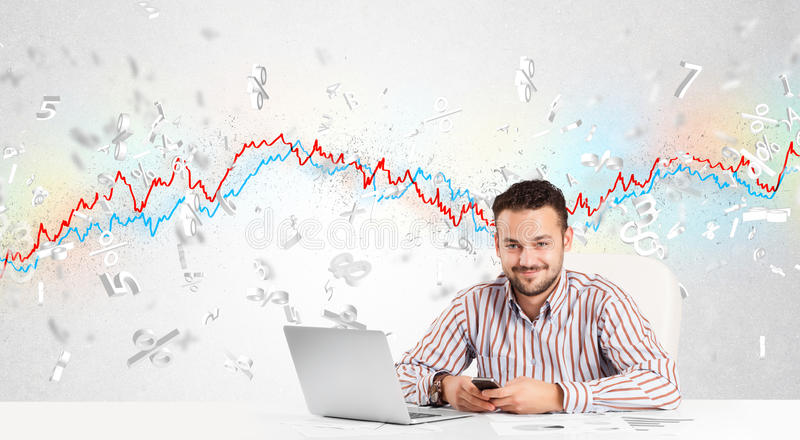 Business man sitting at table with stock market graph. 3d letters royalty free stock photography
