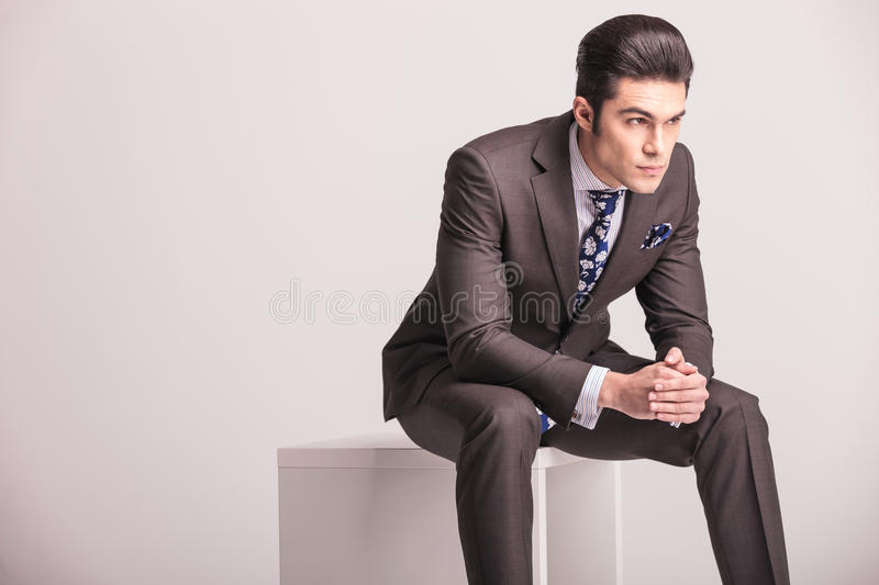 Business man sitting on a white modern chair royalty free stock photo