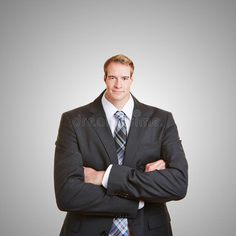 Business man with small head. Funny business man with a small head and his arms crossed royalty free stock photo