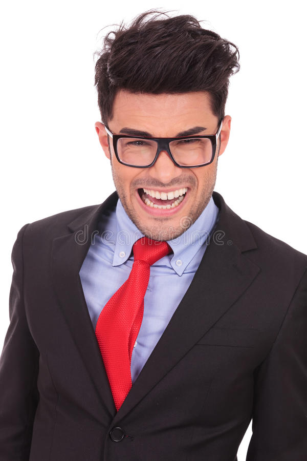 Business man smiling crazy. Portrait of a young business man making a crazy smile, isolated on white royalty free stock images