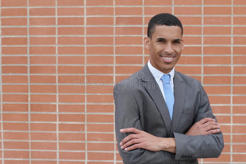 Business Man Smiling Looking at Camera with Arms Crossed with Copy Space stock photography
